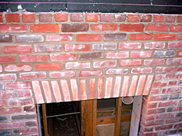 Some custom brickwork above a window opening.